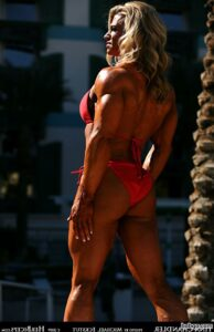 sexy female with muscle body and muscle biceps picture from linkedin