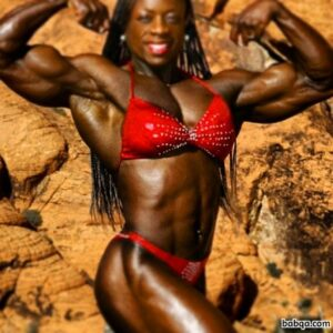spicy lady with fitness body and muscle arms repost from facebook