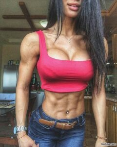 sexy female bodybuilder with strong body and toned arms photo from insta