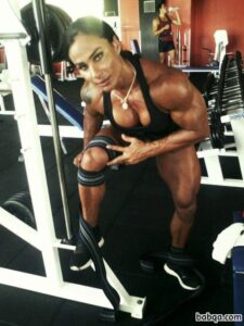 hot chick with fitness body and muscle biceps image from tumblr