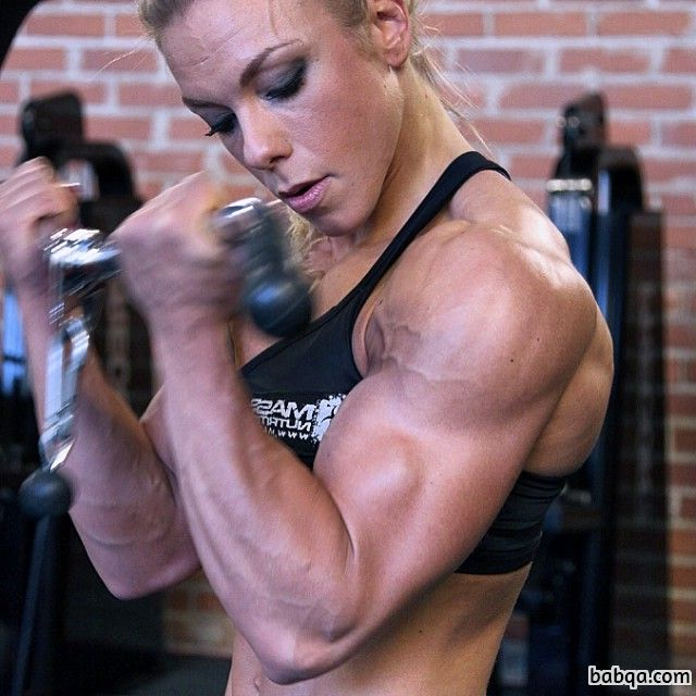awesome lady with muscular body and muscle biceps picture from insta