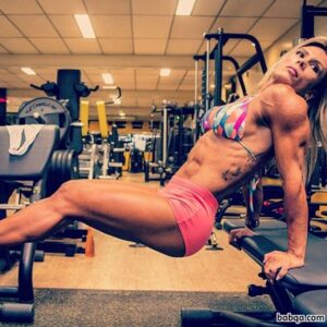 sexy female bodybuilder with strong body and toned booty repost from tumblr