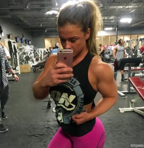 hot female bodybuilder with muscular body and muscle biceps post from insta