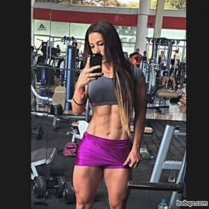 sexy woman with strong body and muscle arms post from instagram