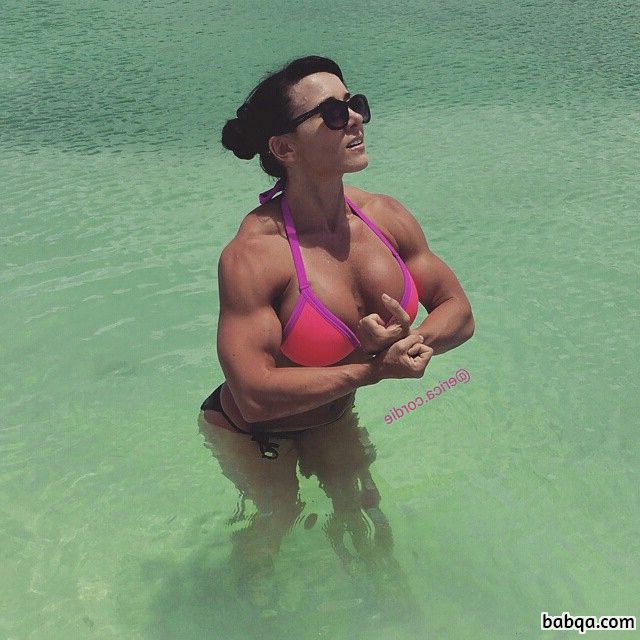 sexy woman with fitness body and muscle biceps post from facebook