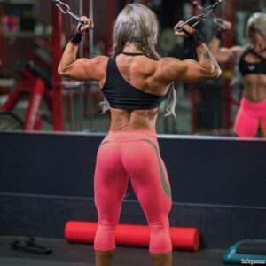 spicy female bodybuilder with fitness body and muscle arms repost from insta