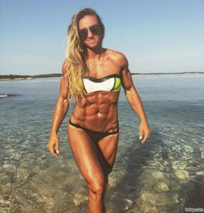 cute girl with muscle body and muscle arms post from instagram