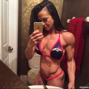 spicy girl with fitness body and muscle biceps picture from insta