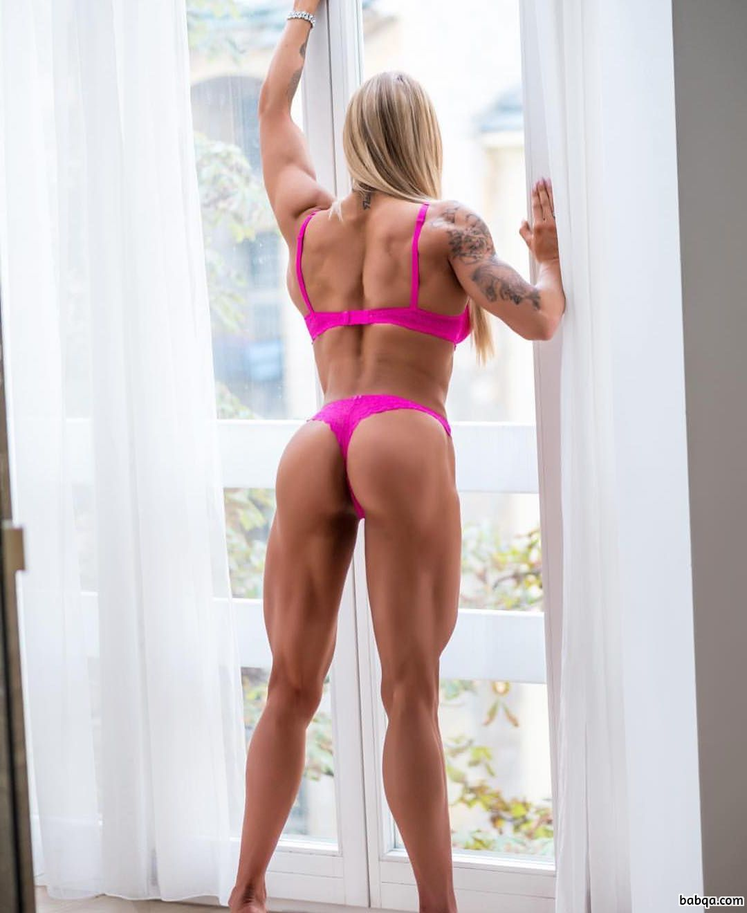 spicy female with fitness body and muscle arms post from instagram