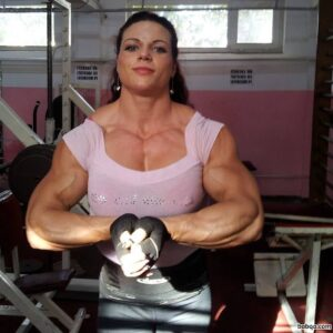 hot female with muscular body and toned biceps post from flickr