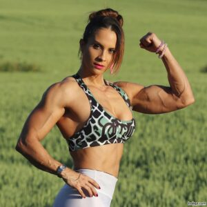 beautiful woman with fitness body and muscle arms photo from linkedin