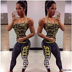 perfect woman with fitness body and muscle bottom photo from insta