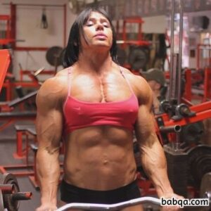 cute female with fitness body and muscle biceps repost from flickr