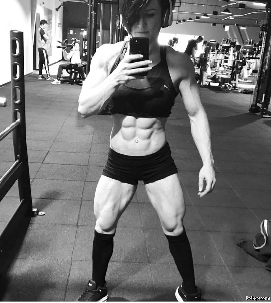 awesome female with fitness body and muscle biceps repost from insta