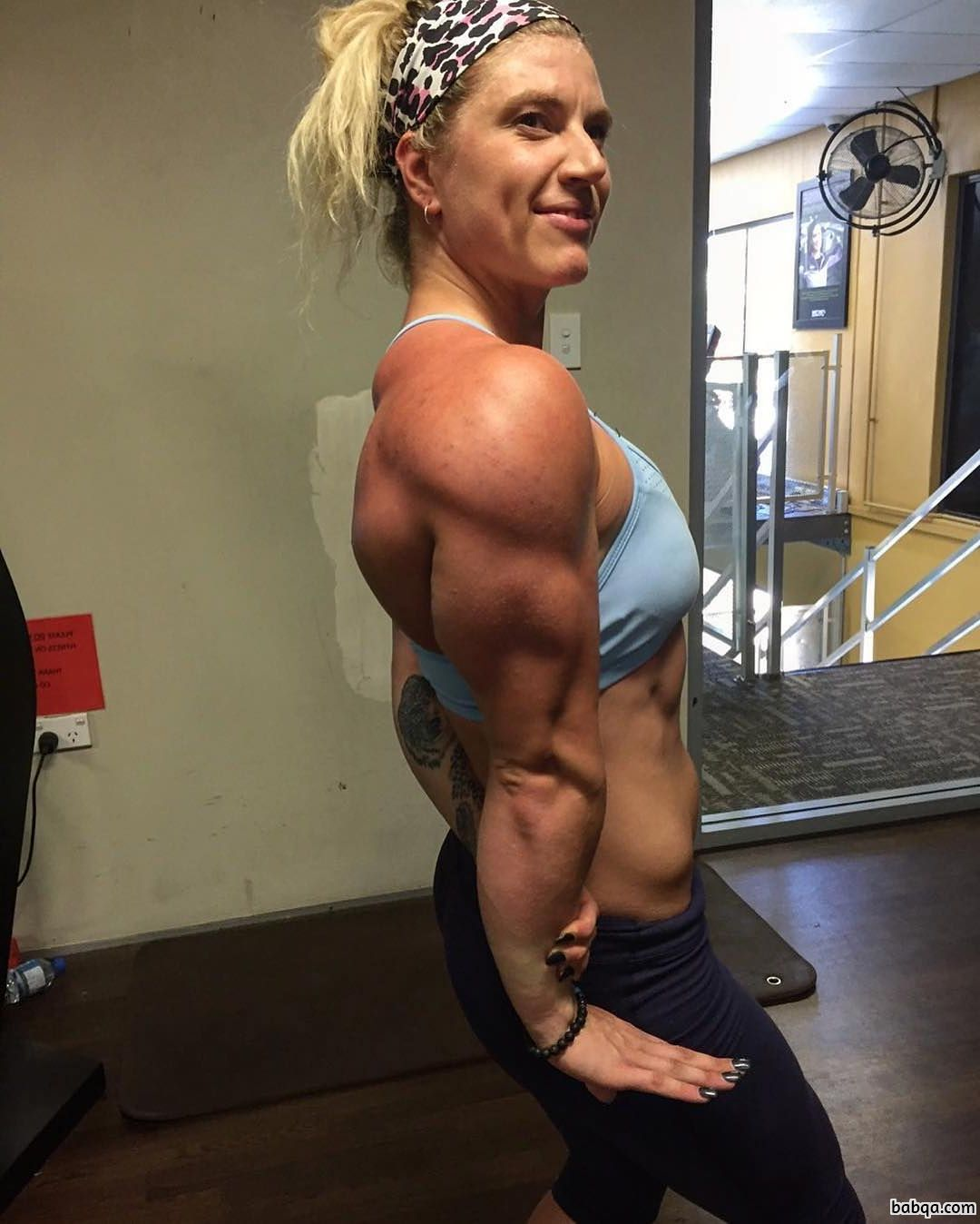 cute woman with muscular body and muscle biceps photo from flickr