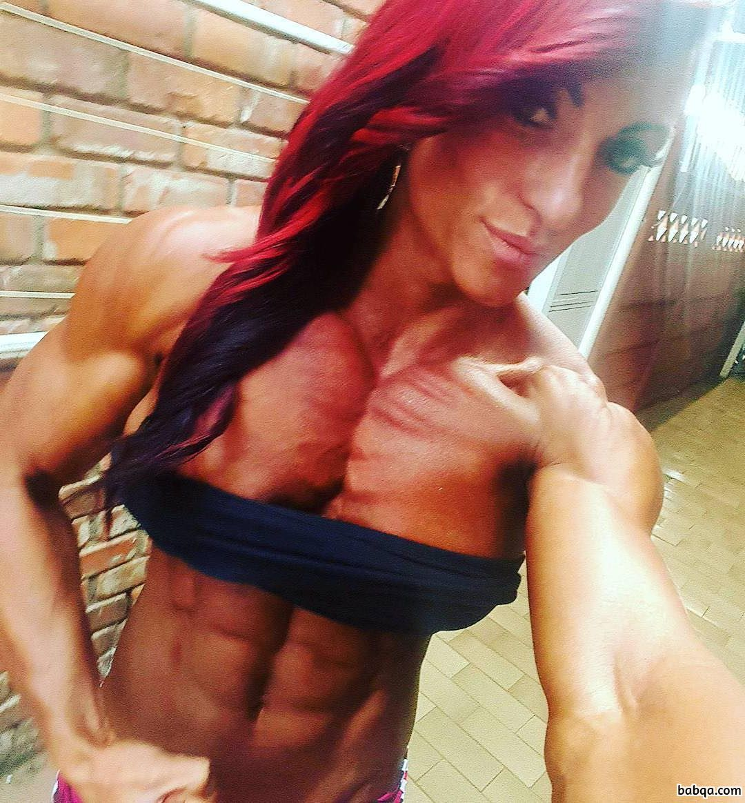 spicy chick with strong body and muscle biceps pic from tumblr