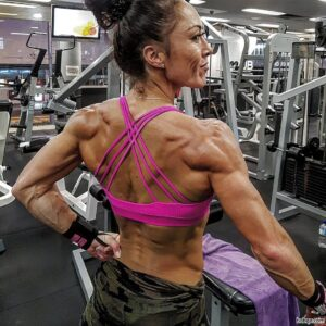hot girl with fitness body and muscle legs photo from linkedin