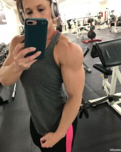 spicy babe with fitness body and muscle biceps post from facebook