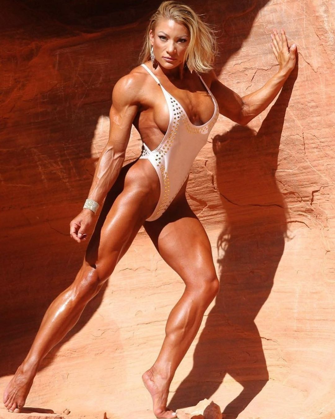 sexy female bodybuilder with muscular body and muscle booty pic from facebook
