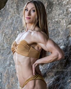 cute female with strong body and muscle biceps image from g+