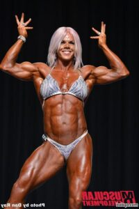 sexy woman with muscular body and muscle biceps repost from facebook