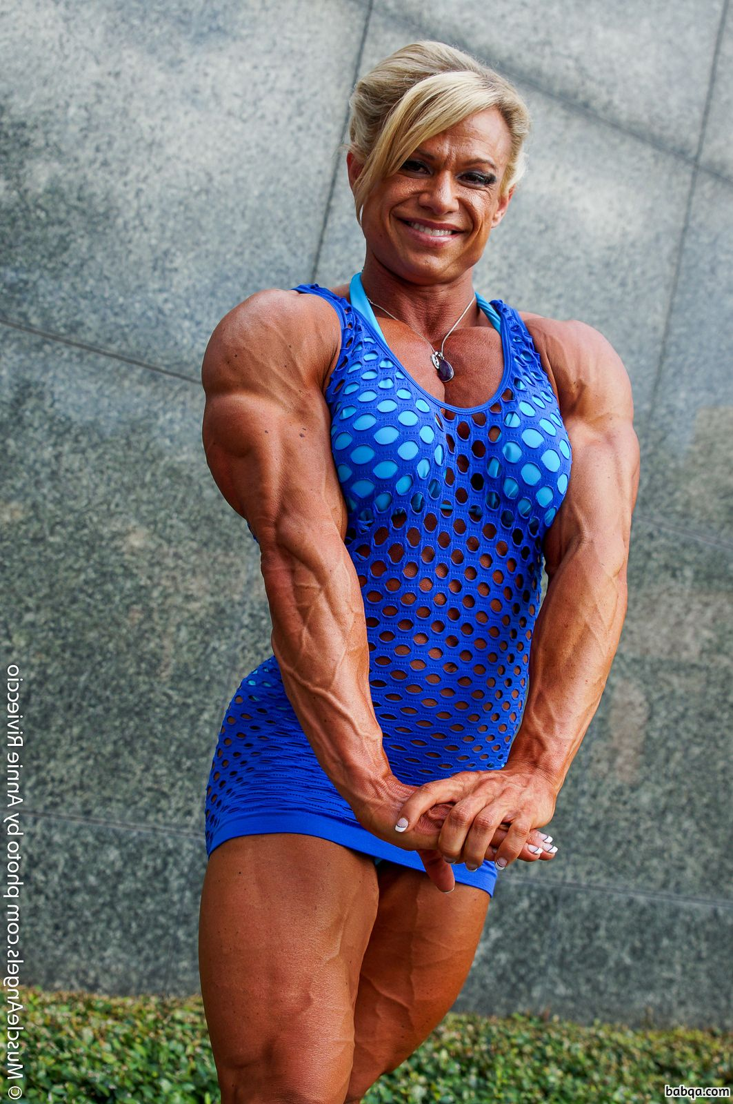 hot lady with fitness body and muscle arms image from facebook