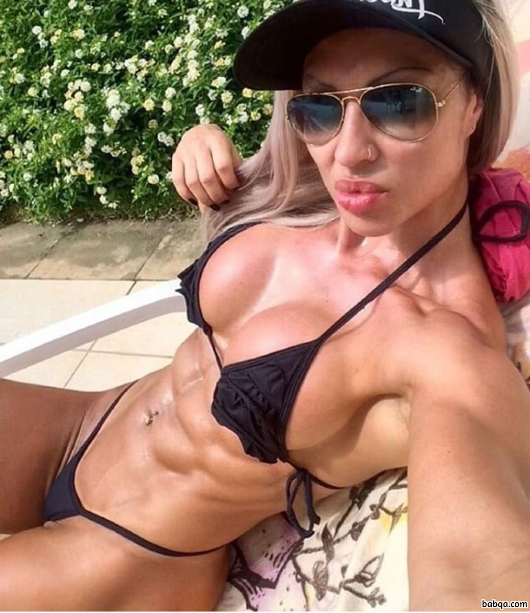 hot chick with muscular body and muscle biceps pic from instagram