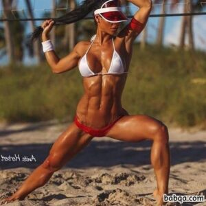 awesome woman with fitness body and muscle biceps pic from instagram